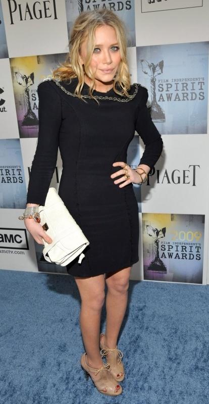 basic black dress with trendy high shoulders